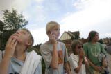 From left to right Kyle Cummings, 10, Jake Cummings, 10, Ian Swartz, 10, and Sam Swartz, 16, watch...