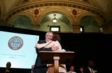 Governor Bill Ritter, left, hugs Colorado State Board of Education member Pamela Jo Suckla, right,...
