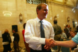 Denver Public Schools Superintendent Michael Bennet is congratulated by a well-wisher after a...