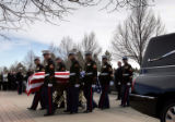(12/20/2004)Denver- Members of a Marine Honor Guard from Buckley Air Force base carry the casket...