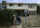 Justin Kaiser (cq) turns the water back on at foreclosed home that he is preping for rental or...