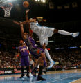 (DENVER, CO., DECEMBER 20, 2004)  Denver Nuggets'#3, DerMarr Johnson, right, trys to go over the...