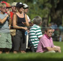 In a black ball cap and sunglasses, Chris Evert blends into the crowd while watching her husband,...