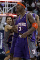 (December 12, 2004) -- Phoenix Suns Quetin Richardson, #3, yells at the Denver Nuggets bench after...