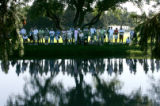 BG_0672 Fans line a lake on the fourth hole as the 2008 U.S. Senior Open at the Broarmoor gets...