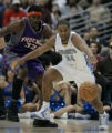 (December 12, 2004) -- Denver Nuggets Andre Miller, #24, loses the ball against Phoenix Suns Amare...
