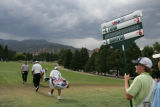 An official carries Eduardo Romero (cq) and Fred Funk's (cq) score along the 18th hole during the...