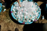 Tubs of water sit out at the finish line of the fifth annual Tri for the Cure triathlon to raise...