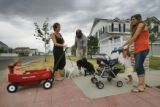 (from right) Rico and Kaya Munn (cq) take their two children 22 month-old Asha Munn (cq) and their...