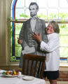 Patricia Perry, chef/owner of Highland's Garden Cafe, with a cardboard cutout of Abe Lincoln.  She...