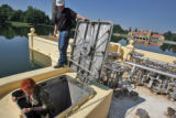 Carla Madison (cq) of the Denver City Council  climbs out of the vault  of the fountain in Ferril...