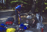 Mike Price (cq) sorts gear in the White River Campground on June 17, 1992. The day before he and...