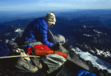 Mike Price (cq) sits in his sleeping bag tethered to an ice screw the morning of June 20, 1992, on...