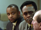 (MONTBELLO, Colo., January 4, 2005) Montbello principal Hansell Gunn (center)  listens to DPS...