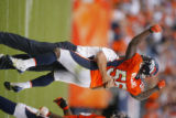 DM1854  Denver Broncos linebacker D.J. Williams #55 jumps into the arms of quarterback coach Pat...