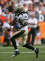 Mike McKenzie returns an interception in the second quarter of the Denver Broncos against the New...