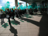 Relatives of organ doors and volunteers release 1,500 green balloons Sunday following a family...