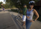 (100)  A Pedal to Properties real estate agent Chris Cullen hands a bike helmet to one of his...