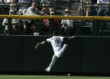 #19 Ryan Spilborghs (cq) misses a fly ball as the Colorado Rockies lose the last game of the...