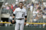 #2 Troy Tulowitzki (cq) walks off the field as the Colorado Rockies lose the last game of the...