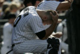 #20 Chris Iannetta (cq) sits in the dugout as the Colorado Rockies lose the last game of the...
