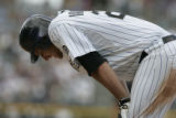 #20 Chris Iannetta (cq) bends over after a failed batting attempt as the Colorado Rockies lose the...