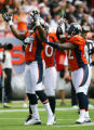 Teammates celebrate with Ebenezer Ekuban after sacking Drew Brees in the first quarter of the...