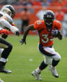 Selvin Young runs in the first quarter of the Denver Broncos against the New Orleans Saints at...