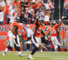 Marquand Manuel celebrates a missed field goal by Martin Gramatica fourth quarter of the Denver...
