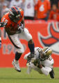 Tracy Porter tackles Selvin Young in the fourth quarter of the Denver Broncos against the New...