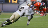 Tracy Porter tackles Eddie Royal in the fourth quarter of the Denver Broncos against the New...