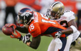 Brandon Marshall makes catch in front of Jason David in the fourth quarter of the Denver Broncos...