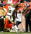 Brandon Marshall catches a pass in front of Jason David in the third quarter of the Denver Broncos...