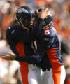 DM0525  Denver Broncos punter Brett Kern #1 congratulates PK Matt Prater #5 after he nailed a...
