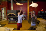Kitchen manager, Gerard Ramierez and Baker, Eric Nelson throw dough at Proto's on Sept. 16, 2008,...