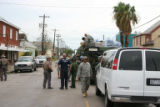 Task Force members of Colorado Task Force 1 come upon an Army vehicle distributing water to...