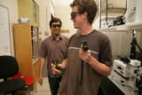 Rahul Trivedi, 24, (cq) and Chris Twombly, 20, (cq) (L-R) discuss research. The University of...