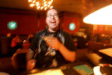 0123 Roman Padilla enjoys happy hour at Dazzle, 930 Lincoln St., a four dollar drink during happy...