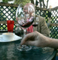 0411 Jim Osberg, laughs with friends through a glass of OZU Zinfandel at the Cork House, 4900 E....