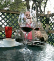 0426 Jim Osberg, laughs with friends through a glass of OZU Zinfandel at the Cork House, 4900 E....