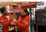 PRN30 - Suresh Joachim (L) and Claudia Wavra (R) celebrate after becoming champions at the Netflix...