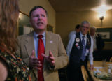 Congressman Doug Lamborn chat with Kathy Newell, club president of the High Noon chapter of ...