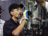 Jeff Cornell (cq) , senior technical brewer at Miller-Coors ,assists with a taste test during...