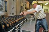 P. J. Coors (cq) loads empts bottles during bottling of AC Golden Brewing's fourth batch of Herman...