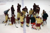 MJM292 David Carle (cq), left, huddles up with the DU hockey team during practice at the...