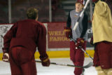 MJM465 David Carle (cq), right, takes part in a drill during hockey practice at the University of...