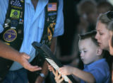 0461  Rayanne Hunter, 25, and her son Westlin, 3, are given a framed print by a member of the...