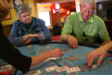 MJM348  Patti Forbes (cq), left, and Keith Sasseen (cq), right, play Blackjack at Century Casino...