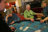 MJM597  Shawn Blondo (cq), left, a card dealer at Century Casino in Central City, Colo. oversees a...