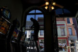 MJM656  Dostal Alley Casino employee, Jose Sandoval (cq) cleans the windows Thursday 09/25/08 at...